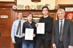 two-male-students-receive-certificates